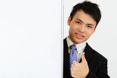 Businessman with thumbs up sign Royalty Free Stock Photos