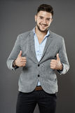 Businessman with thumbs up Stock Images