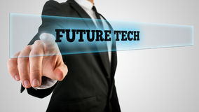 Businessman Ticking a Glass with Future Tech Label. Conceptual Businessman in Black Business Suit Clicking a Glass with a Glowing Future Tech Label, Captured in Stock Photography