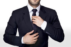 Businessman tie. Businessman adjusting his tie and suit Royalty Free Stock Photos