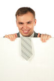 Businessman with tie on board for text royalty free stock photo