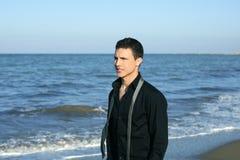 Businessman tie break on the blue beach. Businessman tie break relax walking on the blue beach stock photo