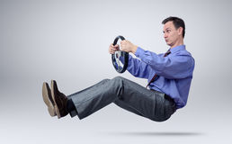 Businessman in tie car driver with a steering wheel Royalty Free Stock Images