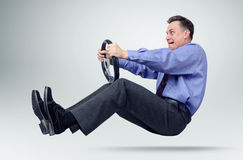 Businessman in tie car driver with a steering wheel stock image