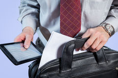Businessman with tie holding a briefcase and tablet pc Royalty Free Stock Photo
