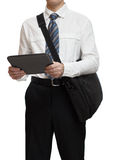 Businessman with tie holding a briefcase and tablet pc Royalty Free Stock Photography