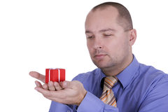 Businessman in tie holding gift box Stock Photography