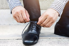 Businessman tie shoelace, Get ready for new challenge concept, L Royalty Free Stock Image