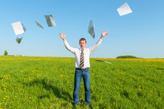 Businessman in a tie throwing papers Royalty Free Stock Photo