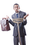 Businessman tied with rope Royalty Free Stock Photos