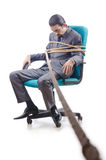 Businessman tied with rope Stock Photo