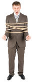Businessman tied with rope Royalty Free Stock Image