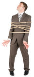 Businessman tied with rope Stock Photography