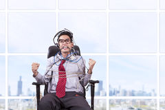 Businessman tied in rope at office Royalty Free Stock Photos