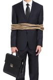 Businessman tied with the rope Stock Photography
