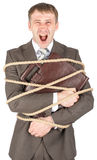 Businessman tied with rope screaming Royalty Free Stock Photos