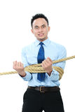 Businessman tied with ropes Stock Images