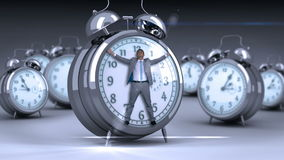 Businessman tied up on alarm clock stock footage