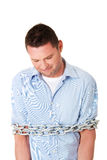 Businessman tied up with chain Stock Image