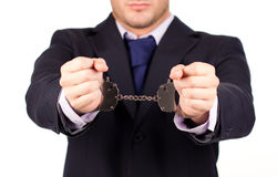Businessman tied up in hand cuffs Stock Photo