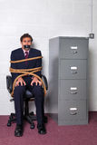 Businessman tied up in the office Royalty Free Stock Image