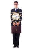 Businessman tied up with rope Stock Photo