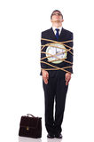 Businessman tied up with rope. On white Royalty Free Stock Photos