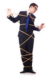 Businessman tied up with rope Royalty Free Stock Photo
