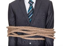 Businessman tied up in rope. Isolated on white Stock Photography
