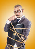 Businessman tied up with rope Stock Photos