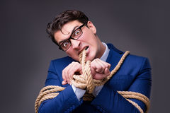 The businessman tied up with rope. Businessman tied up with rope Royalty Free Stock Photo