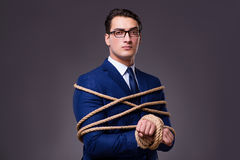 The businessman tied up with rope. Businessman tied up with rope Royalty Free Stock Photography