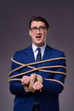 The businessman tied up with rope Stock Image