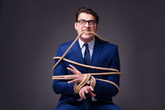 The businessman tied up with rope. Businessman tied up with rope Stock Images