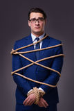 The businessman tied up with rope. Businessman tied up with rope Stock Image