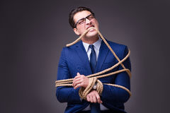 The businessman tied up with rope Royalty Free Stock Image