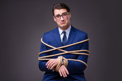 The businessman tied up with rope. Businessman tied up with rope Royalty Free Stock Images