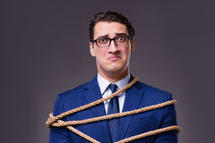 The businessman tied up with rope. Businessman tied up with rope Royalty Free Stock Image