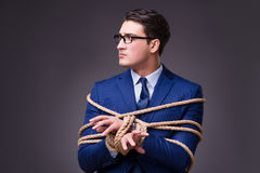 The businessman tied up with rope. Businessman tied up with rope Stock Photo