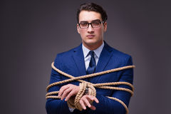 The businessman tied up with rope. Businessman tied up with rope Stock Photography