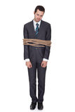 Businessman tied up in rope. Isolated on white Royalty Free Stock Image