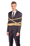 Businessman tied up in rope. Royalty Free Stock Image