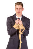 Businessman tied up in rope. Isolated on white Royalty Free Stock Images