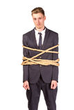 Businessman tied up in rope. Isolated on white Stock Image