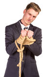 Businessman tied up in rope. Stock Photography
