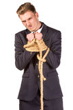 Businessman tied up in rope. Isolated on white Royalty Free Stock Photos
