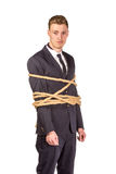 Businessman tied up in rope. Isolated on white Stock Images