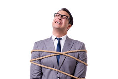 The businessman tied up with rope isolated on white Royalty Free Stock Image
