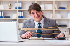 The businessman tied up with rope in office Royalty Free Stock Photo