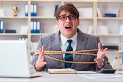 The businessman tied up with rope in office Stock Photography